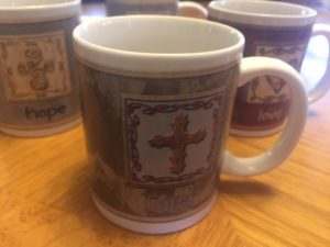 cup with cross and word faith