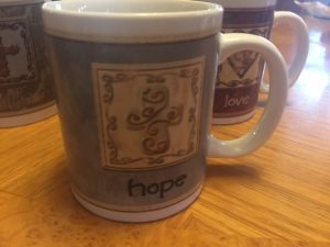cup with word hope and cross