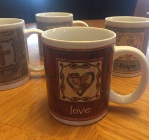 cup with word love and heart