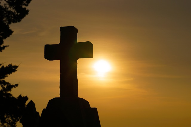 cross with sun behind it