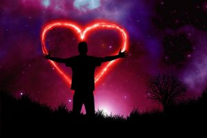 person standing in front of a fiery heart