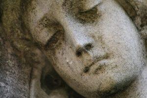 statue of sad face