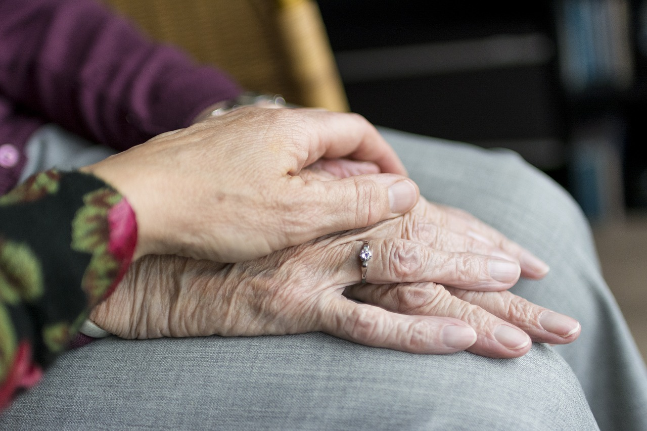 wrinkled hands, one on top of the other