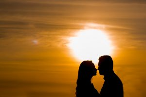 couple outlined against setting sun