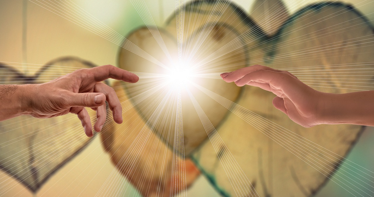 two hands with a bright light between them