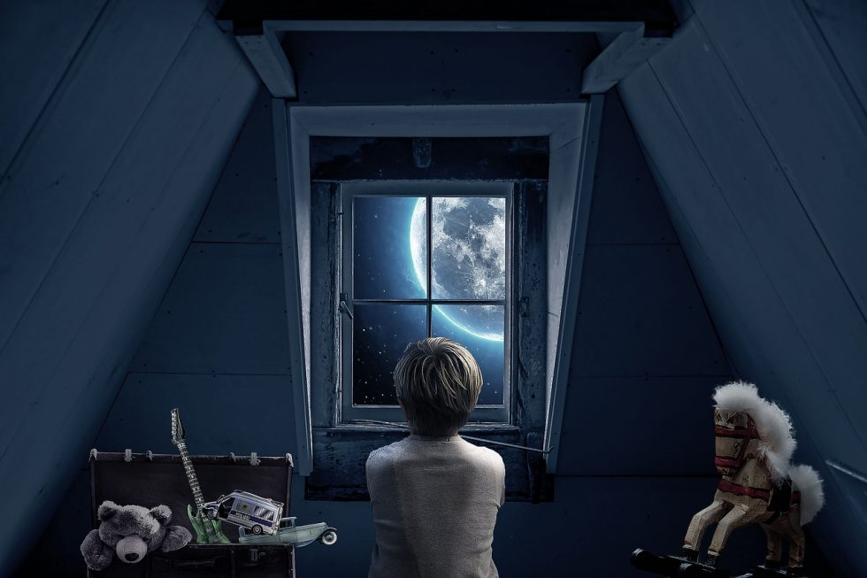 person in attic staring out window at the moon