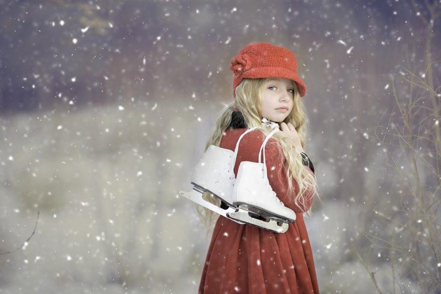 little girl holding ice skates