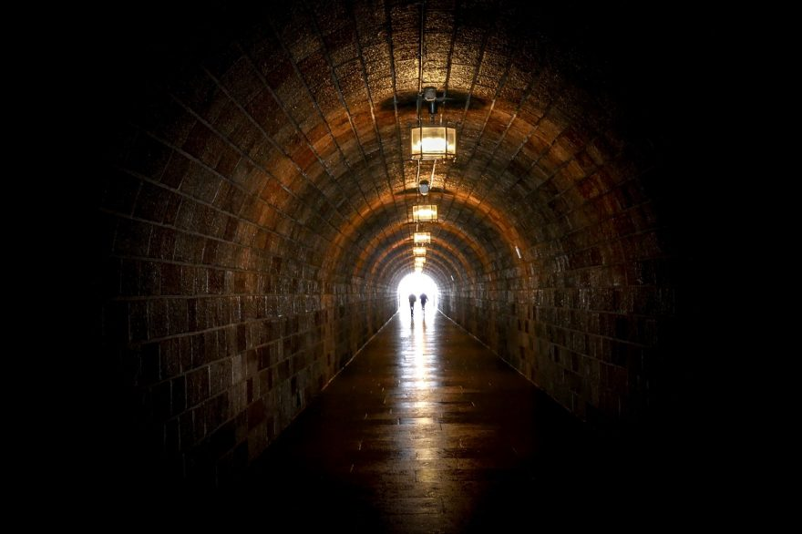 couple at end of long tunnel