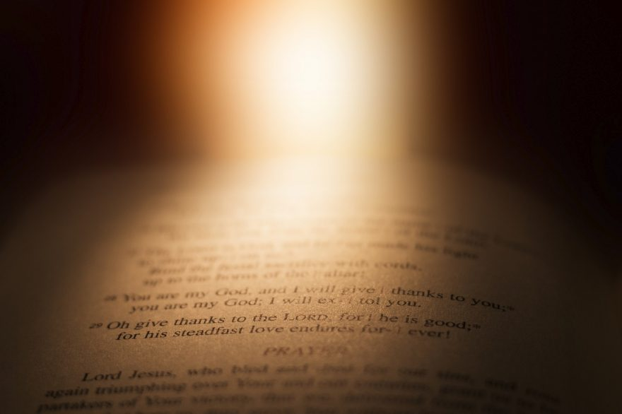 light shining on Bible open to Psalms