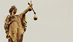woman holding scales of justice